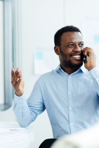An American man using Whatsapp to make international calls.