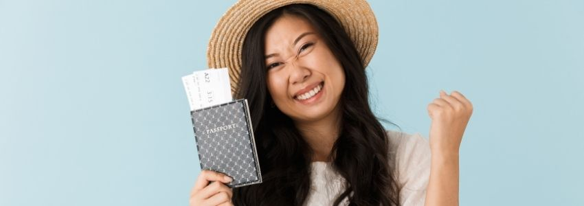 Excited woman holding her passport