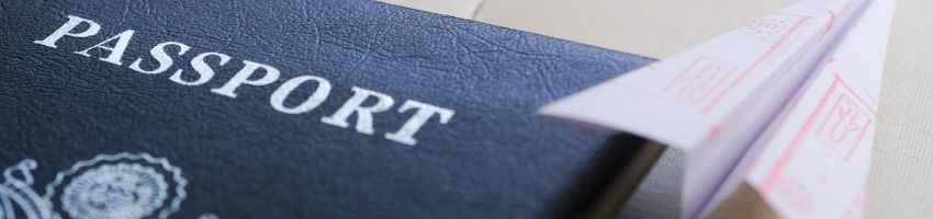A picture of a passport and an airplane paper beside