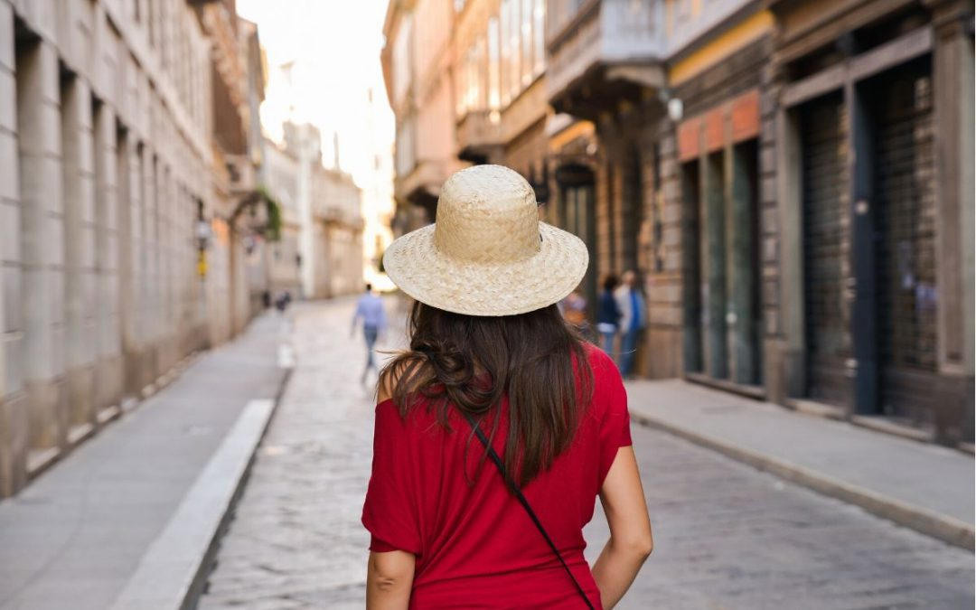 A woman touring the streets of Italy.