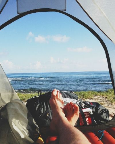 A view of nature from inside a tent.