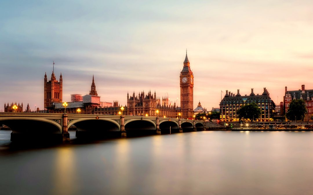 A view of the London skyline at dusk.