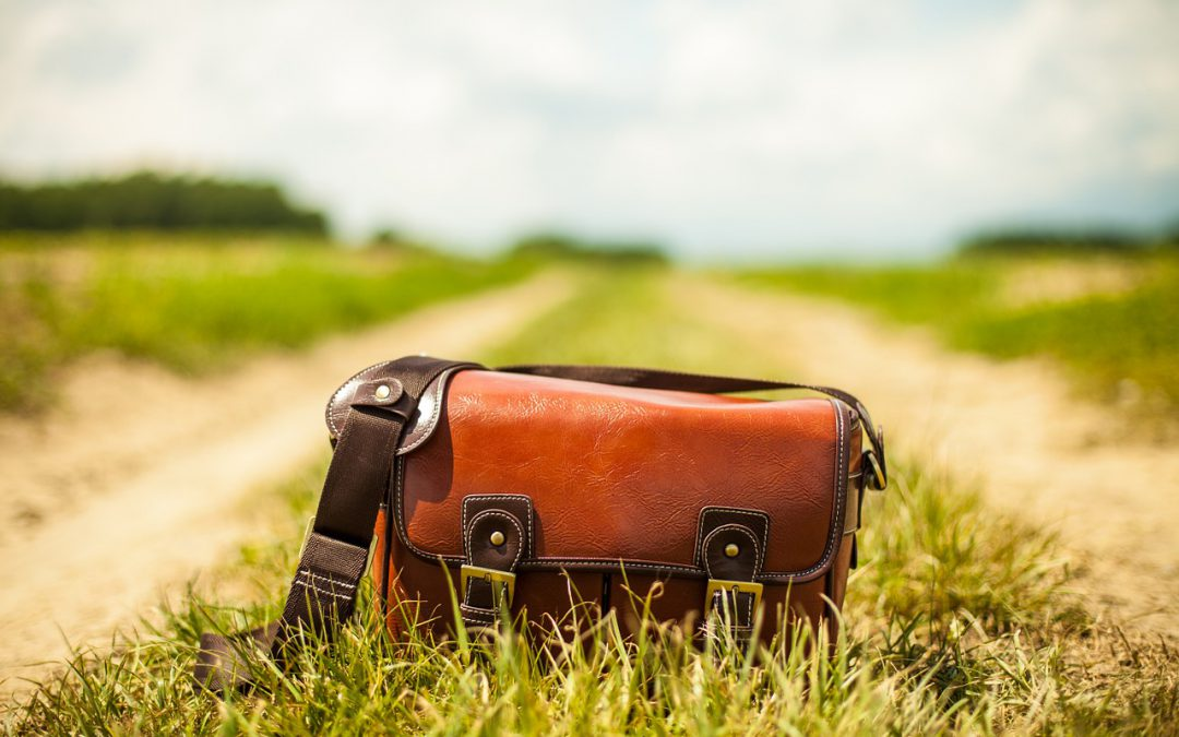 A traveler's purse in the middle of a country lane.
