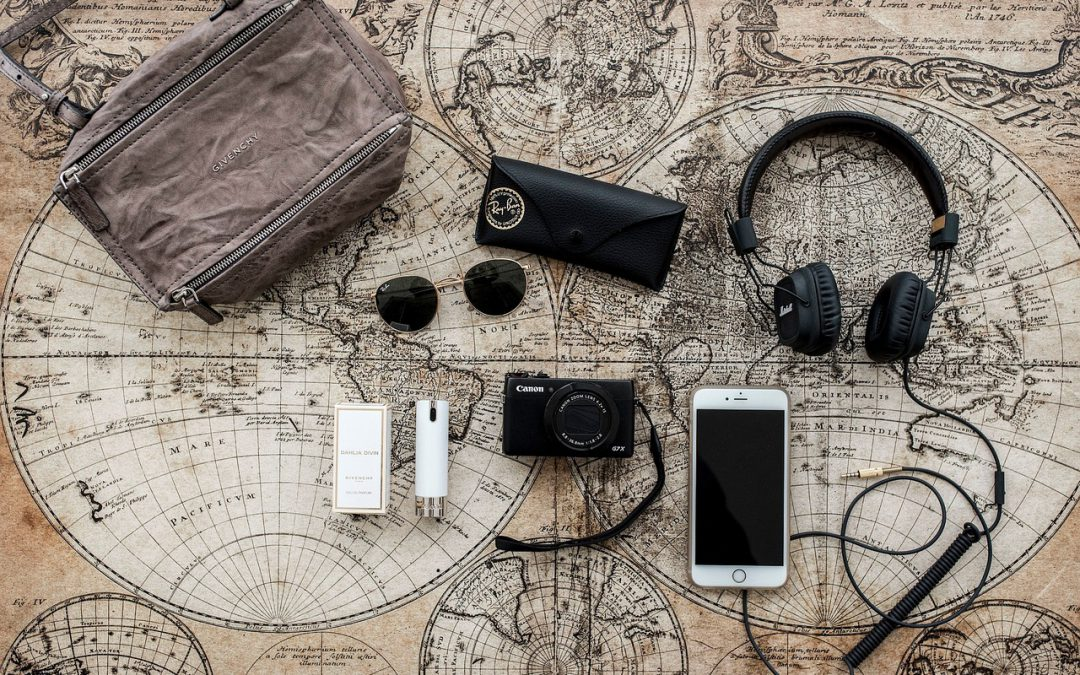Top gadgets for travel on top of the world map.