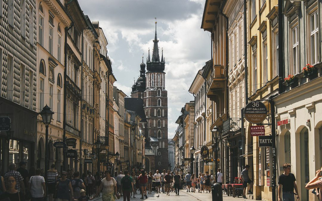 A street in Europe full of tourists and travelers.