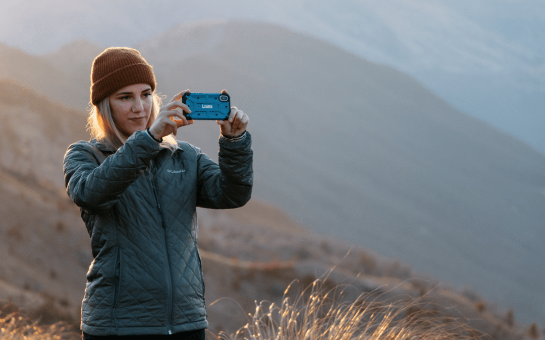 Girl takes a photo with her phone while traveling internationally.