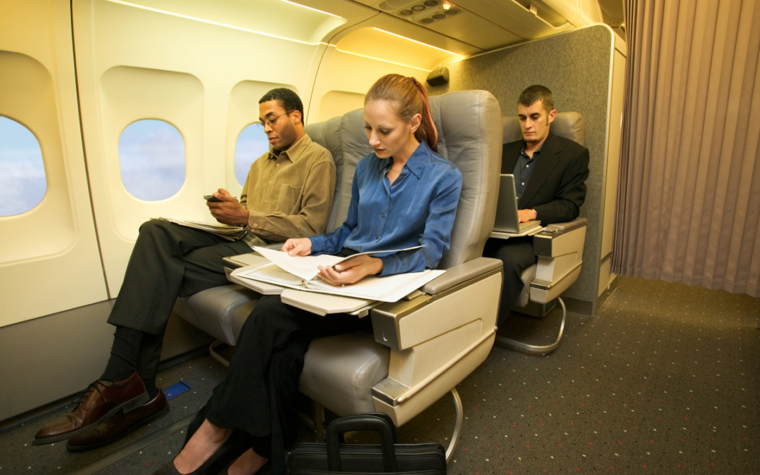 People with jobs in the travel industry are working inside a plane.