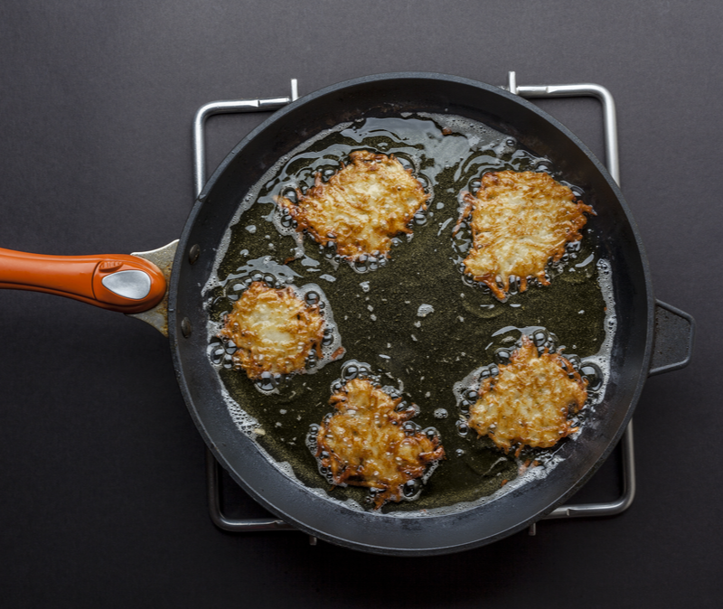 Latkes in a frying pan, done side up