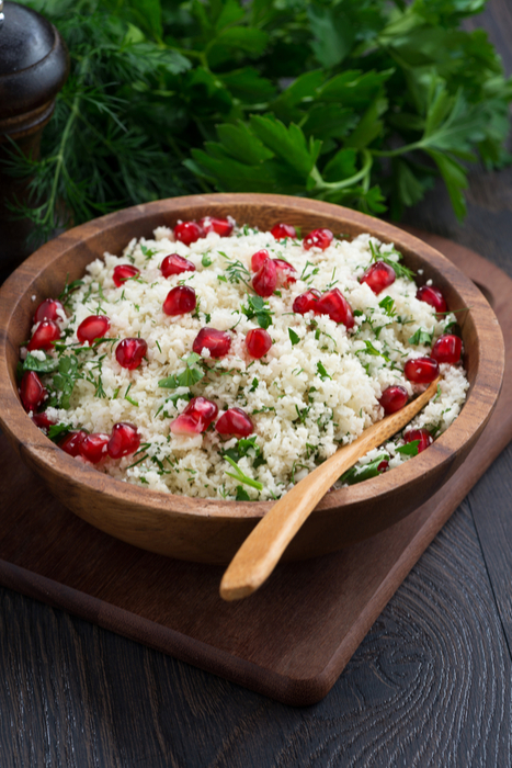 Cauliflower rice tabbouleh, in wooden bowl