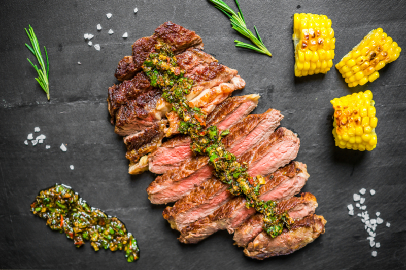 chimichurri on grilled meat, grilled corn on the cob