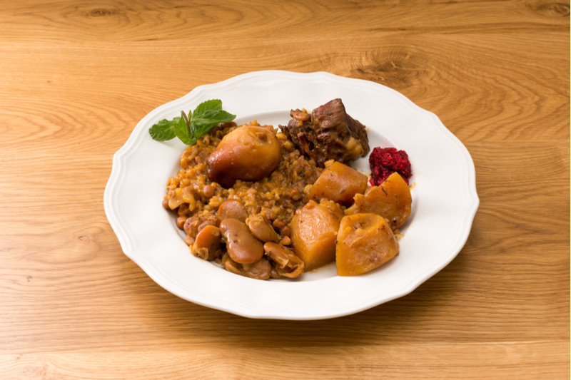 Plate of cholent with garnish