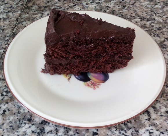 slice of chocolate layer cake with chocolate icing