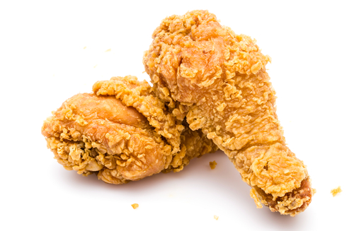 Southern fried chicken drumsticks against white background