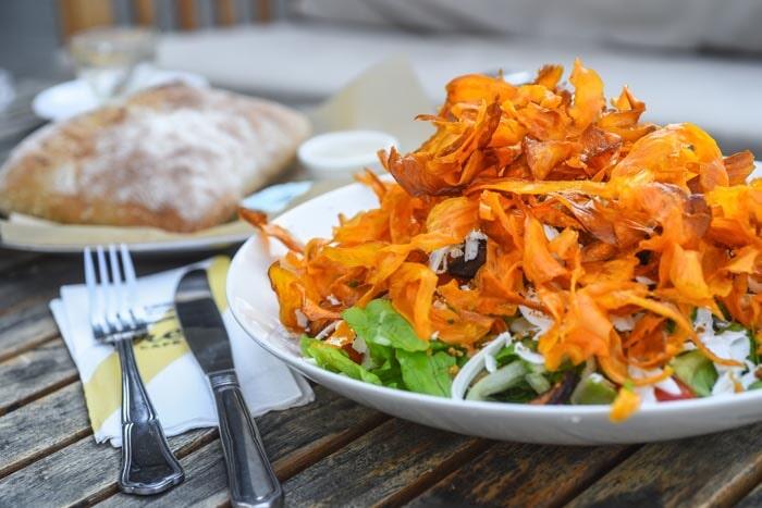 salad piled high with crispy sweet potato strips