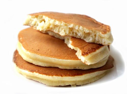 stack of partially eaten, fluffy buttermilk pancakes
