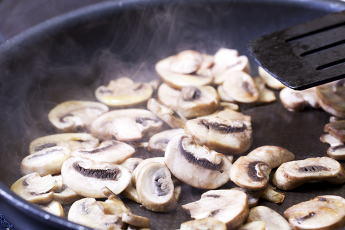 Mushrooms, sauteeing in a pan