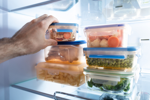Man's hand taking food from freezer
