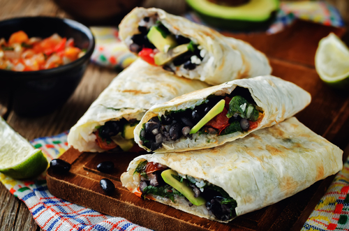 black beans and rice with avocado in a burrito