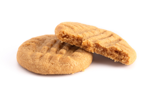 peanut butter cookies stacked on white background