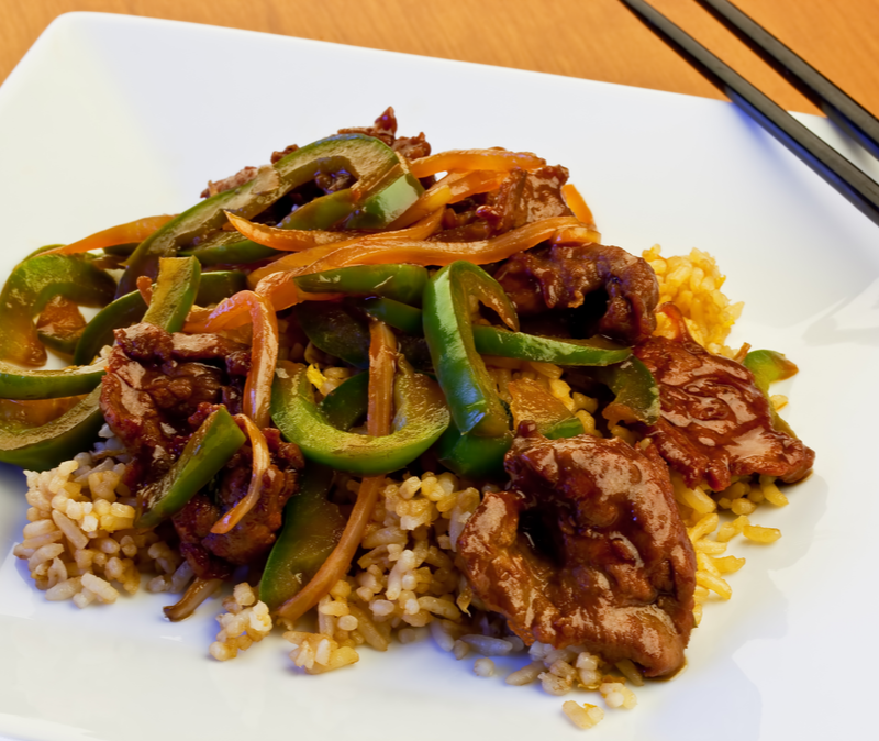 pepper steak on a bed of brown rice