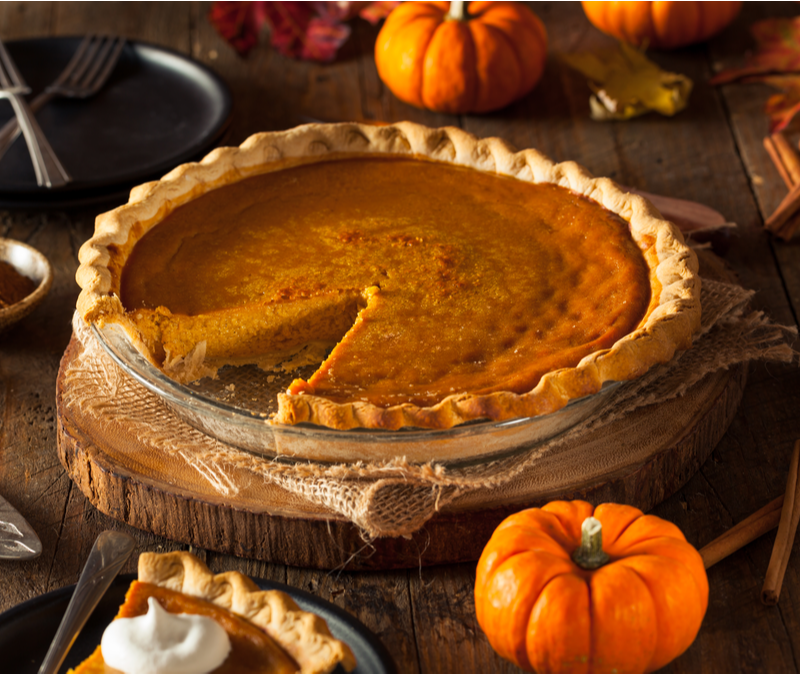 pumpkin pie with one slice removed