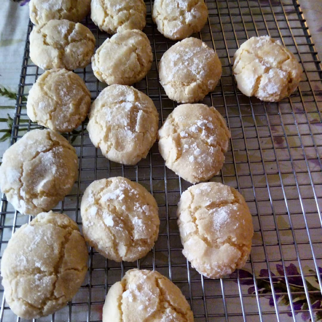 Ricciarelli biscuits cooling on a rack. Italian almond macaroons