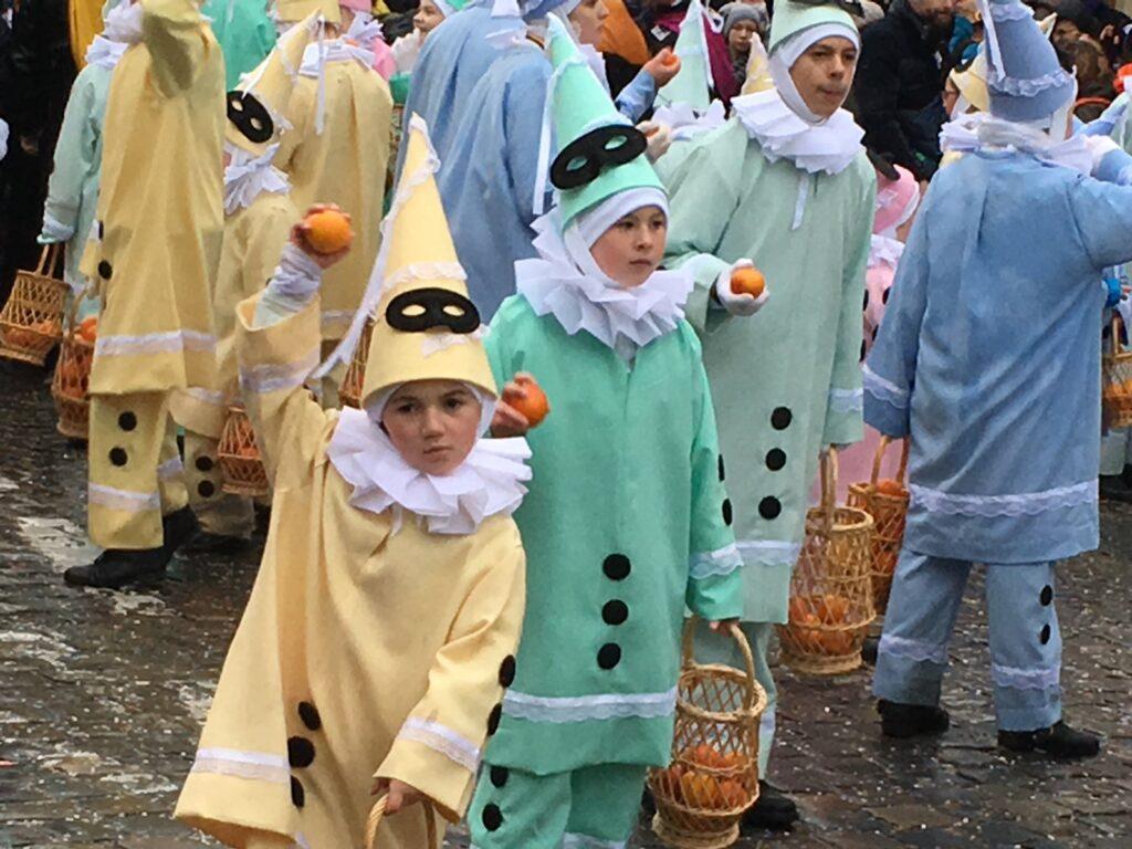 Kids in Binche carnival parade