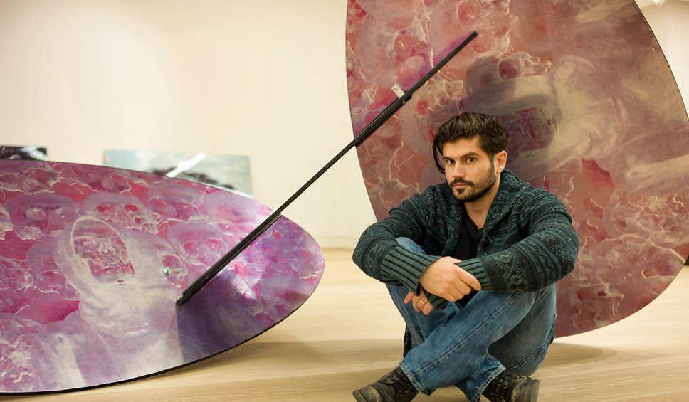 Andrew Levitas with sculpture