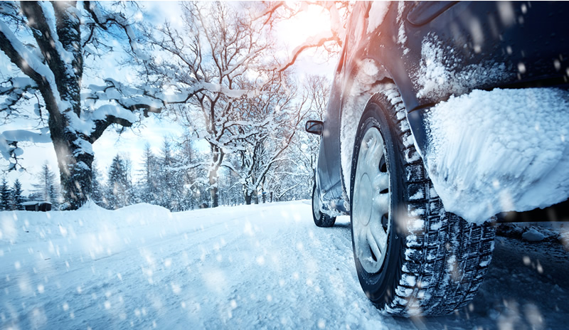 Driving in snowy ice winter weather