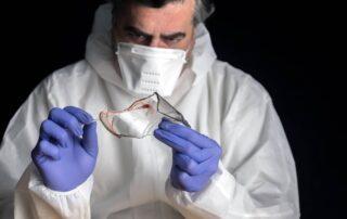 Pharmaceutical worker examining material