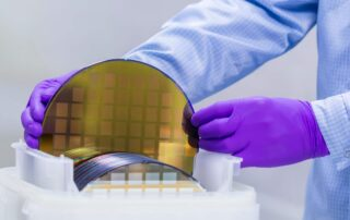 Silicon Wafer with semiconductors in clean room.