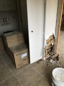Before: termite damage in utility room