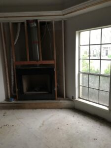 Before:  Primary bedroom & fireplace