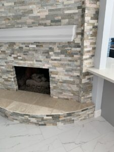 After - stacked stone fireplace