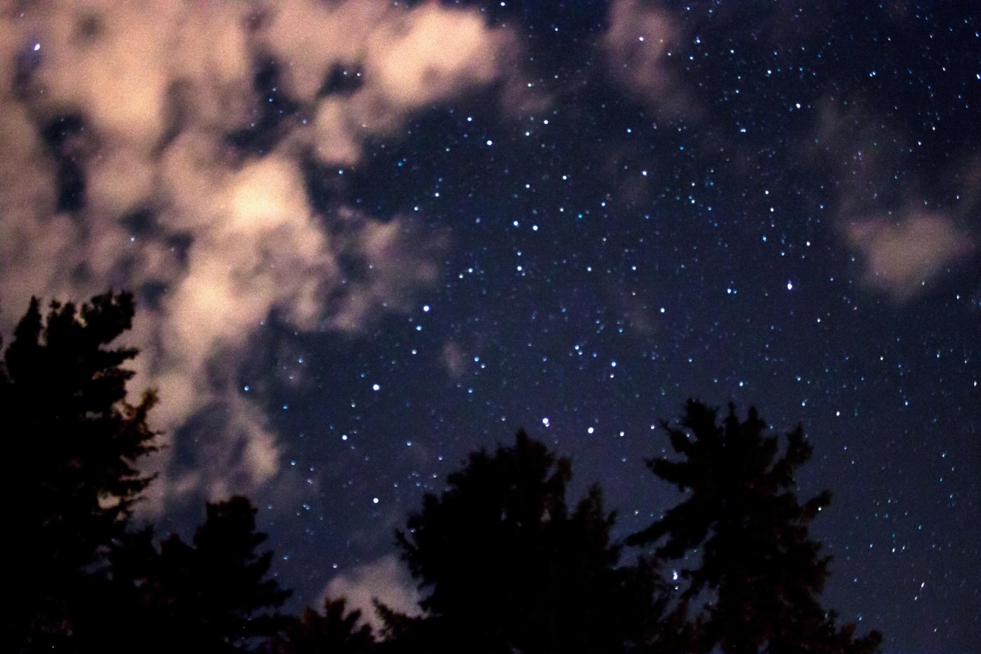 Clouds encroaching on the stars in the night sky above Juneau, Alaska