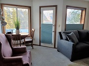 Photo of the living room at one of the fully furnished and equipped, 1-bedroom suites on Douglas Island.