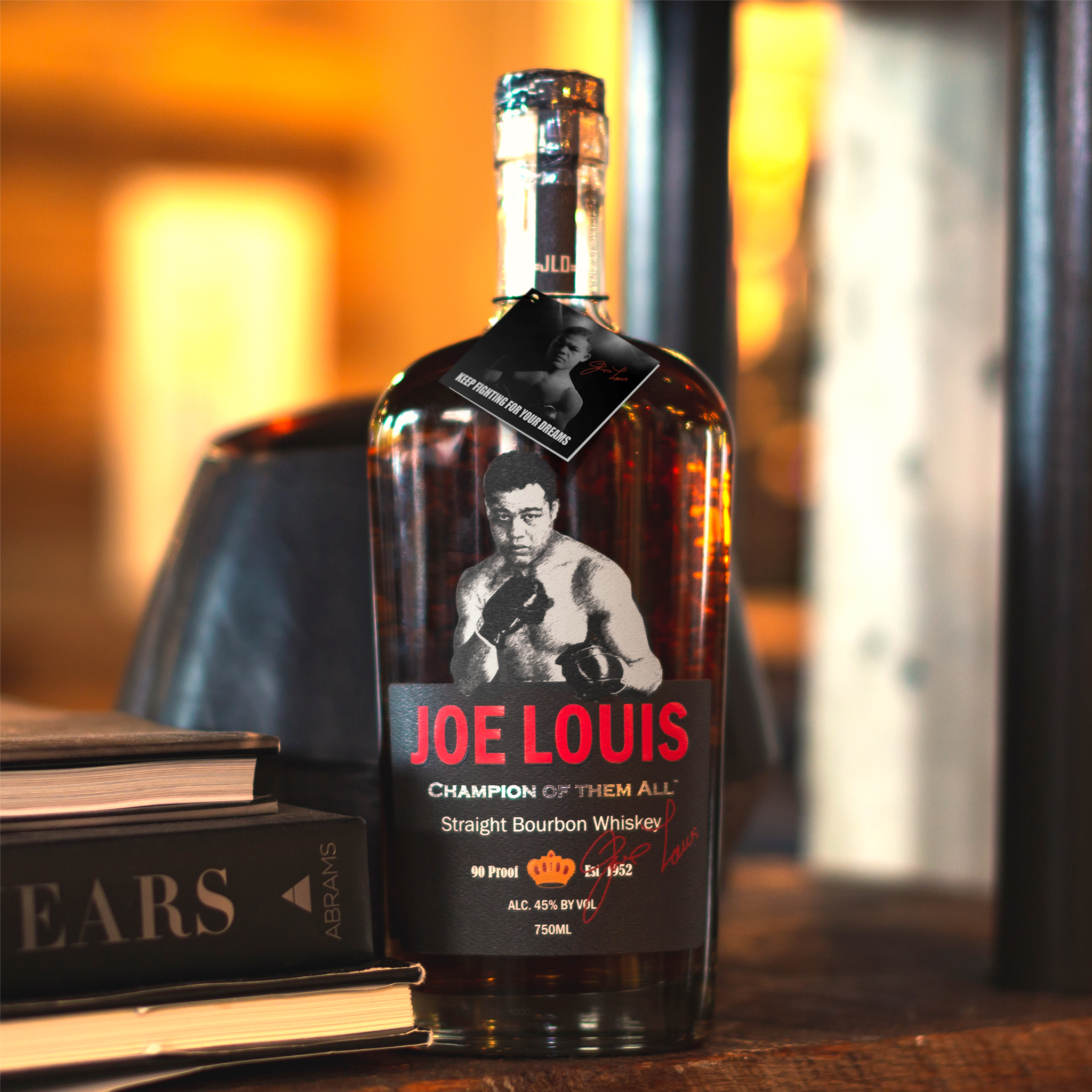 Joe Louis Bourbon Champion of them all - bottle and books, warm background