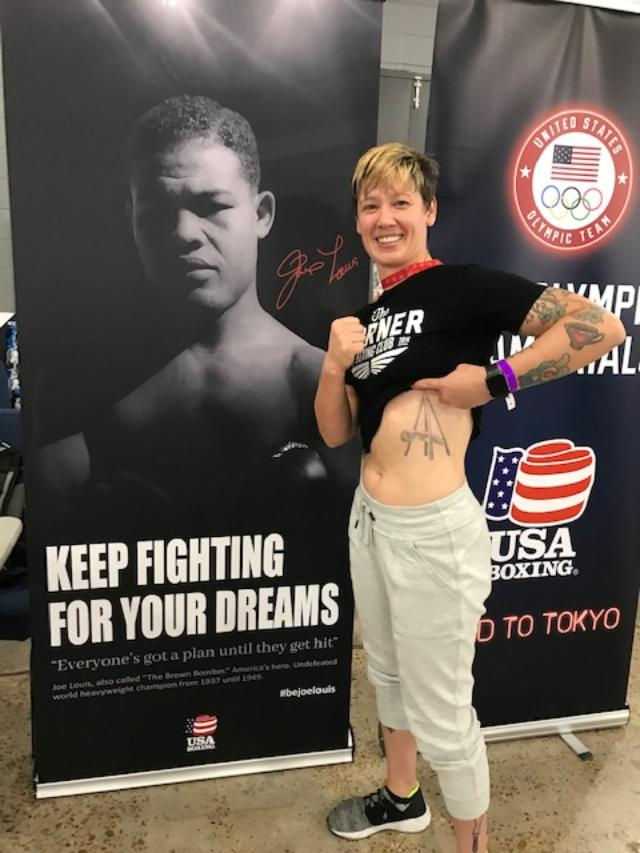 Joe Louis Bourbon - boxing coach shows tattoo of The Monument to Joe Louis, known also as The Fist.