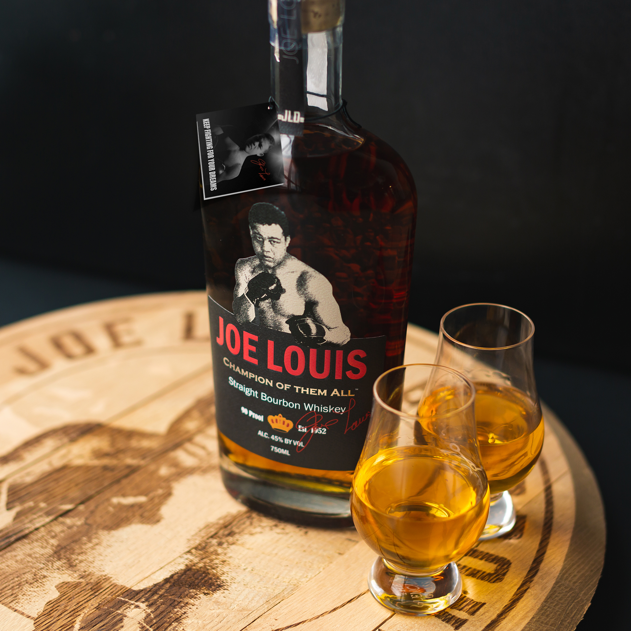 Joe Louis Bourbon Champion of them all - bottle and glass with two bourbon shots, black background