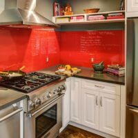 Kitchen with red backsplash