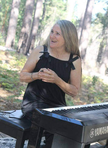 Image of pianist Karen Rhoads at Boggs Mountain Demonstration State Forest