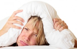 Woman cannot sleep because of insomnia.