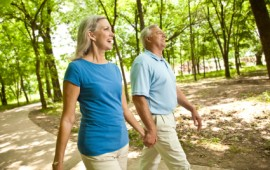 Mature couple walking in the park for exercise.