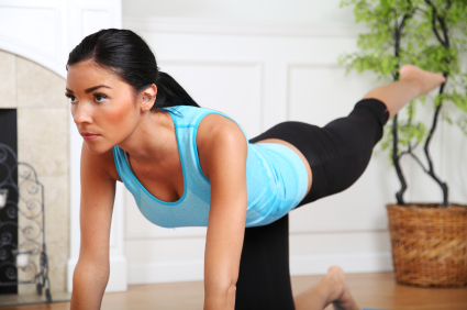 Woman doing leg lift exercise at home.