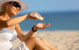 Woman applyign sunscreen