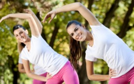 Young women stretching and working out