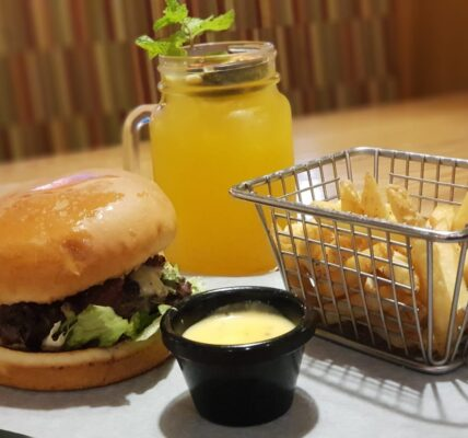California Beef Burger served with Fries in Dinebest