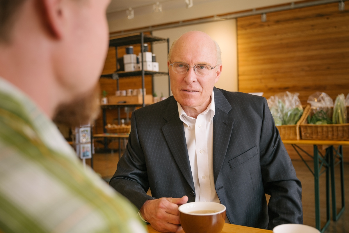 Having a discussion over a cup of coffee