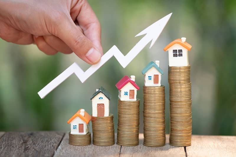 planning savings money of coins to buy a home, concept for property ladder, mortgage and real estate investment. for saving or investment for a house, growing business-cm