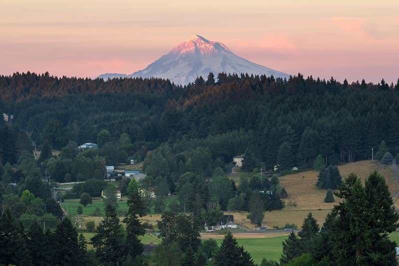Last evening light on Mount Hood over rural farmland in Clackamas County OR USA-cm